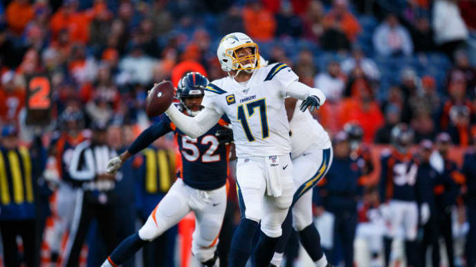 DENVER, CO - DECEMBER 1:  Quarterback Philip Rivers #17 of the Los Angeles Chargers throws a pass while under pressure from linebacker Justin Hollins #52 of the Denver Broncos during the first quarter at Empower Field at Mile High on December 1, 2019 in Denver, Colorado. (Photo by Justin Edmonds/Getty Images)