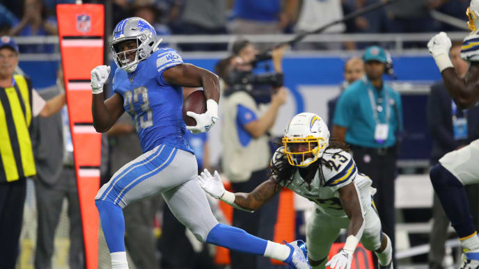 DETROIT, MICHIGAN - SEPTEMBER 15: Kerryon Johnson #33 of the Detroit Lions runs past Rayshawn Jenkins #23 of the Los Angeles Chargers for a first quarter touchdown at Ford Field on September 15, 2019 in Detroit, Michigan. (Photo by Gregory Shamus/Getty Images)