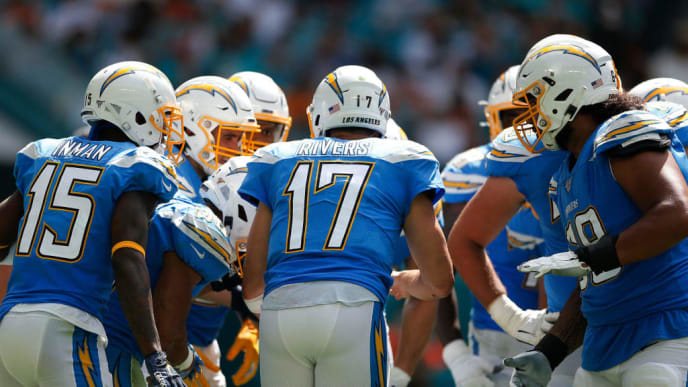 MIAMI, FLORIDA - SEPTEMBER 29: Philip Rivers #17 of the Los Angeles Chargers huddles with the offense against the Miami Dolphins during the third quarter at Hard Rock Stadium on September 29, 2019 in Miami, Florida. (Photo by Michael Reaves/Getty Images)