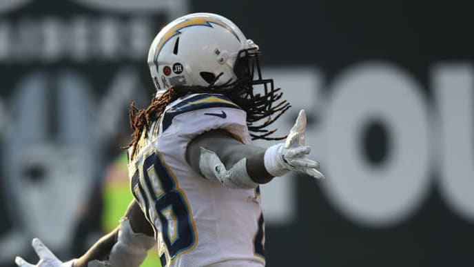 OAKLAND, CA - NOVEMBER 11: Melvin Gordon #28 of the Los Angeles Chargers celebrates after a 66-yard touchdown against the Oakland Raiders during their NFL game at Oakland-Alameda County Coliseum on November 11, 2018 in Oakland, California. (Photo by Ezra Shaw/Getty Images)