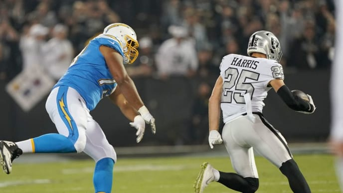 OAKLAND, CALIFORNIA - NOVEMBER 07: Erik Harris #25 of the Oakland Raiders returns an interception for a touchdown sprinting past Trey Pipkins #79 of the Los Angeles Chargers during the first quarter of an NFL football game at RingCentral Coliseum on November 07, 2019 in Oakland, California. (Photo by Thearon W. Henderson/Getty Images)