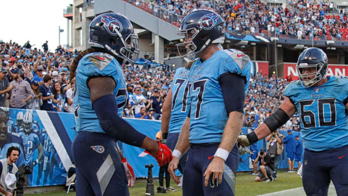 NASHVILLE, TENNESSEE - OCTOBER 20:  Derrick Henry #22 of the Tennessee Titans is congratulated by teammate Ryan Tannehill #17 after scoring a touchdown against the Los Angeles Chargers during the second half at Nissan Stadium on October 20, 2019 in Nashville, Tennessee. (Photo by Frederick Breedon/Getty Images)
