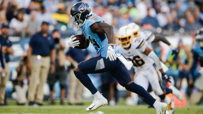 NASHVILLE, TENNESSEE - OCTOBER 20: Corey Davis #84 of the Tennessee Titans runs with the ball against the Los Angeles Chargers during the third quarter at Nissan Stadium on October 20, 2019 in Nashville, Tennessee. (Photo by Silas Walker/Getty Images)