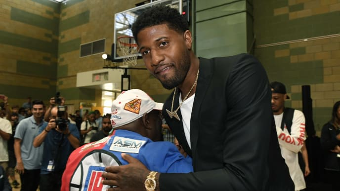 LOS ANGELES, CA - JULY 24: Paul George arrives for the introductory news conference by the Los Angeles Clippers at Green Meadows Recreation Center on July 24, 2019 in Los Angeles, California. NOTE TO USER: User expressly acknowledges and agrees that, by downloading and or using this photograph, User is consenting to the terms and conditions of the Getty Images License Agreement. at Green Meadows Recreation Center on July 24, 2019 in Los Angeles, California. (Photo by Kevork Djansezian/Getty Images)