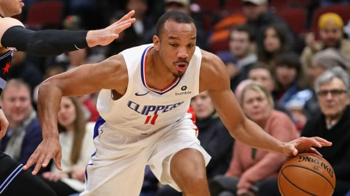 CHICAGO, ILLINOIS - JANUARY 25: Avery Bradley #11 of the LA Clippers moves against Ryan Arcidiacono #51 of the Chicago Bulls at the United Center on January 25, 2019 in Chicago, Illinois. NOTE TO USER: User expressly acknowledges and agrees that, by downloading and or using this photograph, User is consenting to the terms and conditions of the Getty Images License Agreement. (Photo by Jonathan Daniel/Getty Images)