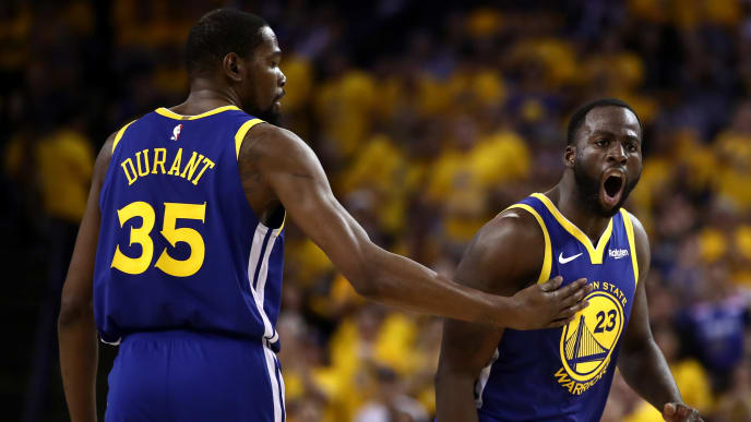 OAKLAND, CALIFORNIA - APRIL 24:  Draymond Green #23 of the Golden State Warriors reacts to a call as Kevin Durant #35 holds him back during their game against the LA Clippers during Game Five of the first round of the 2019 NBA Western Conference Playoffs at ORACLE Arena on April 24, 2019 in Oakland, California. NOTE TO USER: User expressly acknowledges and agrees that, by downloading and or using this photograph, User is consenting to the terms and conditions of the Getty Images License Agreement. (Photo by Ezra Shaw/Getty Images)