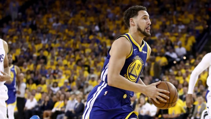 OAKLAND, CALIFORNIA - APRIL 24:  Klay Thompson #11 of the Golden State Warriors in action against the LA Clippers during Game Five of the first round of the 2019 NBA Western Conference Playoffs at ORACLE Arena on April 24, 2019 in Oakland, California. NOTE TO USER: User expressly acknowledges and agrees that, by downloading and or using this photograph, User is consenting to the terms and conditions of the Getty Images License Agreement. (Photo by Ezra Shaw/Getty Images)