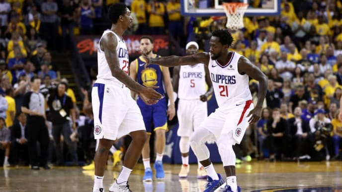 OAKLAND, CALIFORNIA - APRIL 24:  Patrick Beverley #21 of the LA Clippers congratulates Lou Williams #23 of the LA Clippers after he made a basket against the Golden State Warriors during Game Five of the first round of the 2019 NBA Western Conference Playoffs at ORACLE Arena on April 24, 2019 in Oakland, California. NOTE TO USER: User expressly acknowledges and agrees that, by downloading and or using this photograph, User is consenting to the terms and conditions of the Getty Images License Agreement. (Photo by Ezra Shaw/Getty Images)