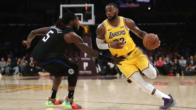 LOS ANGELES, CALIFORNIA - MARCH 04:  LeBron James #23 of the Los Angeles Lakers dribbles past Montrezl Harrell #5 of the Los Angeles Clippers during the second half of a game against the LA Clippers at Staples Center on March 04, 2019 in Los Angeles, California.  The Los Angeles Clippers defeated the Los Angeles Lakers 113-105.  (Photo by Sean M. Haffey/Getty Images)