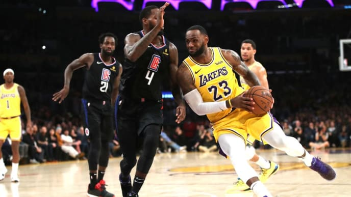 LOS ANGELES, CALIFORNIA - MARCH 04:  LeBron James #23 of the Los Angeles Lakers dribbles past JaMychal Green #4 of the Los Angeles Clippers during the second half of a game against the Los Angeles Clippers at Staples Center on March 04, 2019 in Los Angeles, California.  The Los Angeles Clippers defeated the Los Angeles Lakers 113-105.  (Photo by Sean M. Haffey/Getty Images)