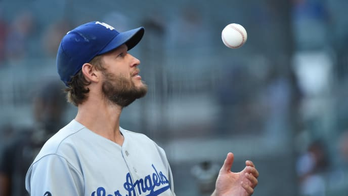 ATLANTA, GEORGIA - AUGUST 17: Clayton Kershaw #22 of the Los Angeles Dodgers stands in the dugout against the Atlanta Braves at SunTrust Park in the first inning on August 17, 2019 in Atlanta, Georgia. (Photo by Logan Riely/Getty Images)