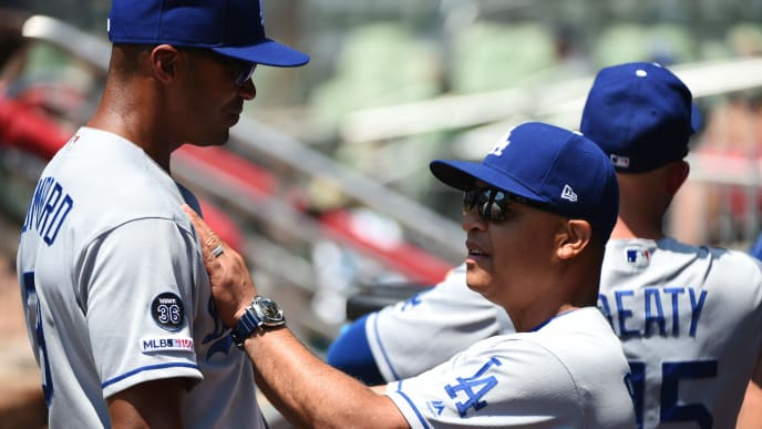 ATLANTA, GEORGIA - AUGUST 18: Dave Roberts #30 of the Los Angeles Dodgers talks in the dugout before the game against the Atlanta Braves at SunTrust Park on August 18, 2019 in Atlanta, Georgia. (Photo by Logan Riely/Getty Images)