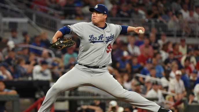 ATLANTA, GEORGIA - AUGUST 17: Hyun-Jin Ryu #99 of the Los Angeles Dodgers pitches in the fifth inning against the Atlanta Braves at SunTrust Park on August 17, 2019 in Atlanta, Georgia. (Photo by Logan Riely/Getty Images)