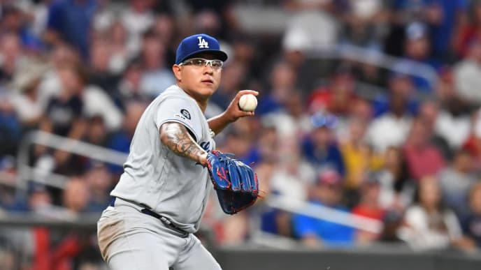 ATLANTA, GA - AUGUST 16: Julio Urias #7 of the Los Angeles Dodgers throws out a runner from his knees for the final out of the game against the Atlanta Braves at SunTrust Park on August 16, 2019 in Atlanta, Georgia. (Photo by Scott Cunningham/Getty Images)