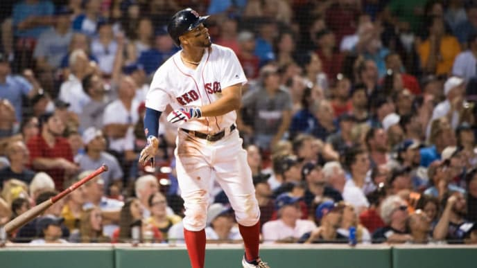 BOSTON, MA - JULY 14: Xander Bogaerts #2 of the Boston Red Sox hits a home run in the eighth inning against the Los Angeles Dodgers at Fenway Park on July 14, 2019 in Boston, Massachusetts. (Photo by Kathryn Riley/Getty Images)