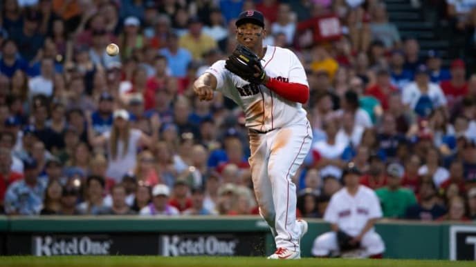 BOSTON, MA - JULY 13: Rafael Devers #11 of the Boston Red Sox throws to first base for an out against the Los Angeles Dodgers during the third inning at Fenway Park on July 13, 2019 in Boston, Massachusetts. (Photo by Rich Gagnon/Getty Images)