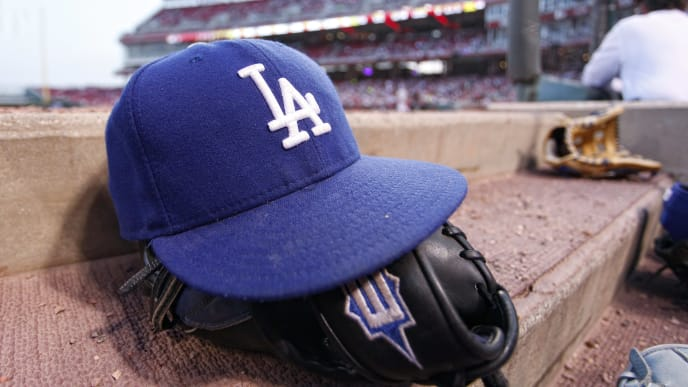 CINCINNATI, OH - APRIL 21:  Detail view of a Los Angeles Dodgers baseball cap and glove during the game against the Cincinnati Reds at the Great American Ball Park on April 21, 2010 in Cincinnati, Ohio. The Dodgers won 14-6. (Photo by Joe Robbins/Getty Images)
