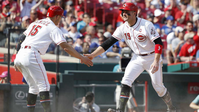 CINCINNATI, OH - MAY 18: Joey Votto #19 and Nick Senzel #15 of the Cincinnati Reds celebrate after scoring runs in the third inning following a single by Yasiel Puig against the Los Angeles Dodgers at Great American Ball Park on May 18, 2019 in Cincinnati, Ohio. (Photo by Joe Robbins/Getty Images)