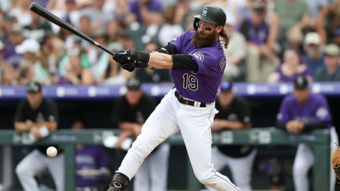 DENVER, COLORADO - JUNE 30: Charlie Blackmon #19 of the Colorado Rockies hits a RBI single in the fifth inning against the Los Angeles Dodgers at Coors Field on June 30, 2019 in Denver, Colorado. (Photo by Matthew Stockman/Getty Images)