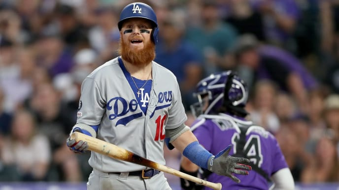 DENVER, COLORADO - JUNE 29: Justin Turner #10 of the Los Angeles Dodgers strikes out to end the top of the seventh inning against the Colorado Rockies at Coors Field on June 29, 2019 in Denver, Colorado. (Photo by Matthew Stockman/Getty Images)