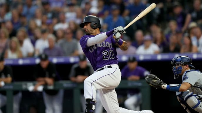 DENVER, COLORADO - JUNE 29: Ian Desmond #20 of the Colorado Rockies hits a single in the sixth inning against the Los Angeles Dodgers at Coors Field on June 29, 2019 in Denver, Colorado. (Photo by Matthew Stockman/Getty Images)