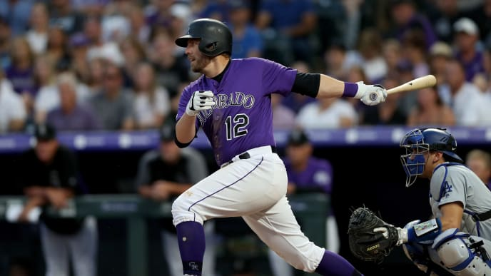 DENVER, COLORADO - JUNE 29: Mark Reynolds #12 of the Colorado Rockies hits a 2 RBI single in the sixth inning against the Los Angeles Dodgers at Coors Field on June 29, 2019 in Denver, Colorado. (Photo by Matthew Stockman/Getty Images)