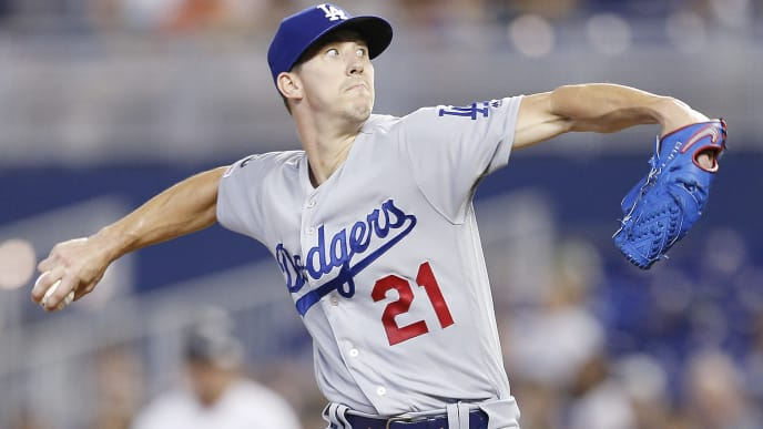 MIAMI, FLORIDA - AUGUST 15:  Walker Buehler #21 of the Los Angeles Dodgers delivers a pitch against the Miami Marlins during the first inning at Marlins Park on August 15, 2019 in Miami, Florida. (Photo by Michael Reaves/Getty Images)