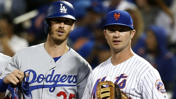 NEW YORK, NEW YORK - SEPTEMBER 14: Cody Bellinger #35 of the Los Angeles Dodgers stands at first base with Pete Alonso #20 of the New York Mets after his base hit in the second inning at Citi Field on September 14, 2019 in New York City. (Photo by Jim McIsaac/Getty Images)
