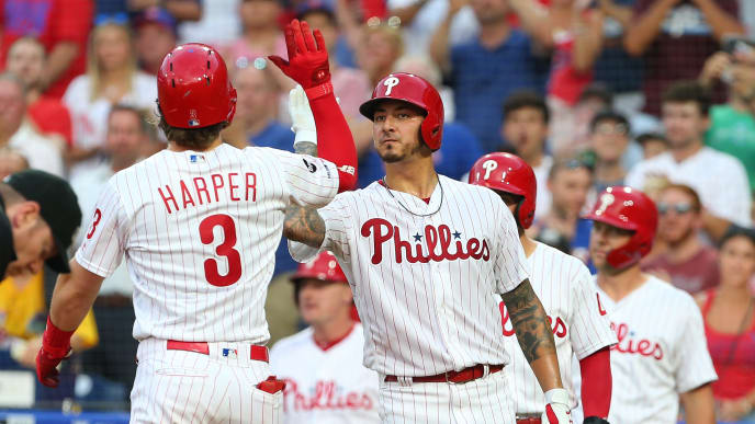 PHILADELPHIA, PA - JULY 16: Bryce Harper #3 of the Philadelphia Phillies is congratulated by Brad Miller #33 after hitting a two-run home run against the Los Angeles Dodgers during the second inning of a baseball game at Citizens Bank Park on July 16, 2019 in Philadelphia, Pennsylvania. (Photo by Rich Schultz/Getty Images)