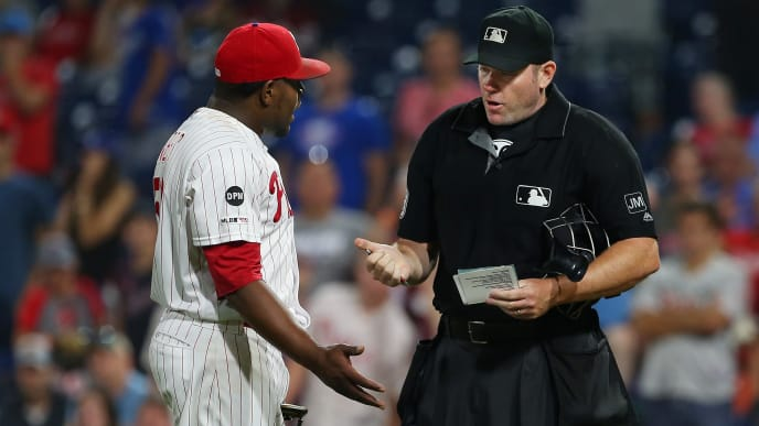 PHILADELPHIA, PA - JULY 16: Closer Hector Neris #50 of Philadelphia Phillies questions home plate umpire Chris Conroy on his ejection from the game after he hit David Freese #25 of the Los Angeles Dodgers in the head during the ninth inning of a baseball game at Citizens Bank Park on July 16, 2019 in Philadelphia, Pennsylvania. The Phillies defeated the Dodgers 9-8. (Photo by Rich Schultz/Getty Images)