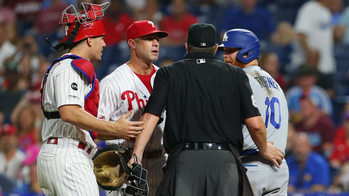 PHILADELPHIA, PA - JULY 15: Home plate umpire Doug Eddings gets between catcher J.T. Realmuto #10 and manager Gabe Kapler #19 of the Philadelphia Phillies and Justin Turner #10 of the Los Angeles Dodgers after Turner was hit by a pitch during the eighth inning of a baseball game at Citizens Bank Park on July 15, 2019 in Philadelphia, Pennsylvania. (Photo by Rich Schultz/Getty Images)