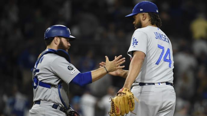 SAN DIEGO, CA - SEPTEMBER 25: Kenley Jansen #74 of the Los Angeles Dodgers, right, is congratulated by Russell Martin #55 of the Los Angeles Dodgers after getting the final out during the ninth inning of a baseball game at Petco Park September 25, 2019 in San Diego, California.  (Photo by Denis Poroy/Getty Images)