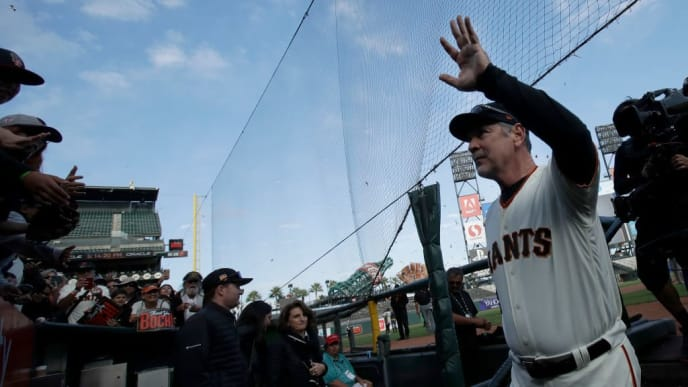 SAN FRANCISCO, CALIFORNIA - SEPTEMBER 29: Manager Bruce Bochy #15 of the San Francisco Giants waves to fans as he exits the field during a ceremony honoring Bochy after a baseball game between the San Fransisco Giants and the Los Angeles Dodgers on September 29, 2019 in San Fransisco, California (Photo by Jeff Chiu - Pool/Getty Images)