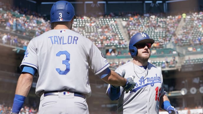 SAN FRANCISCO, CALIFORNIA - SEPTEMBER 28: Max Muncy #13 of the Los Angeles Dodgers is congratulated by Chris Taylor #3 after Muncy's solo home run against the San Francisco Giants in the top of the six inning at Oracle Park on September 28, 2019 in San Francisco, California. (Photo by Thearon W. Henderson/Getty Images)