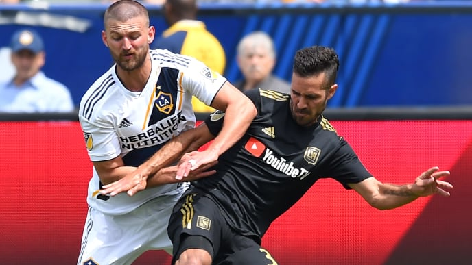 CARSON, CA - MARCH 31:  Perry Kitchen #2 of Los Angeles Galaxy and Steven Beitashour #3 of Los Angeles FC battle for the ball in the second half of the game as  at StubHub Center on March 31, 2018 in Carson, California.  (Photo by Jayne Kamin-Oncea/Getty Images)