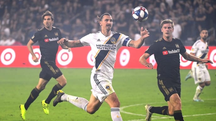 LOS ANGELES, CALIFORNIA - OCTOBER 24:  Zlatan Ibrahimovic #9 of Los Angeles Galaxy runs after a pass in front of Dejan Jakovic #5 of Los Angeles FC during the Western Conference Semifinals at Banc of California Stadium on October 24, 2019 in Los Angeles, California. (Photo by Harry How/Getty Images)