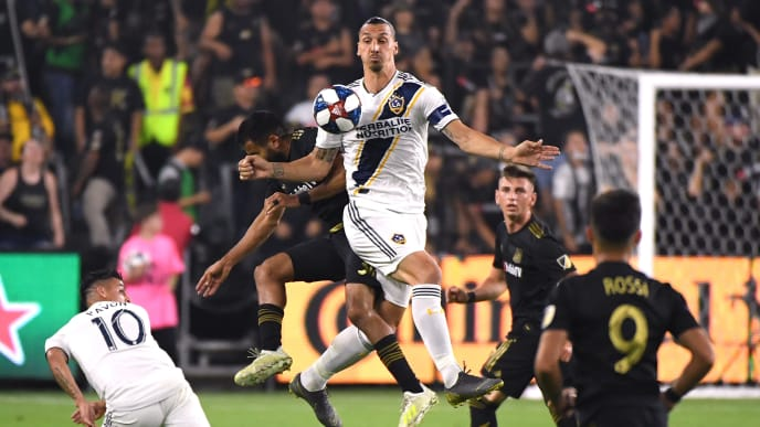 LOS ANGELES, CALIFORNIA - OCTOBER 24:  Zlatan Ibrahimovic #9 of Los Angeles Galaxy plays a ball off his chest in front of Steven Beitashour #3 of Los Angeles FC during the first half of the Western Conference Semifinals at Banc of California Stadium on October 24, 2019 in Los Angeles, California. (Photo by Harry How/Getty Images)