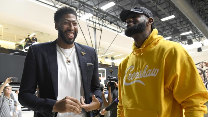 EL SEGUNDO, CALIFORNIA - JULY 13: Anthony Davis (L) talks with LeBron James as Davis is introduced as the newest player of the Los Angeles Lakers during a press conference at UCLA Health Training Center on July 13, 2019 in El Segundo, California. NOTE TO USER: User expressly acknowledges and agrees that, by downloading and/or using this Photograph, user is consenting to the terms and conditions of the Getty Images License Agreement. (Photo by Kevork Djansezian/Getty Images)