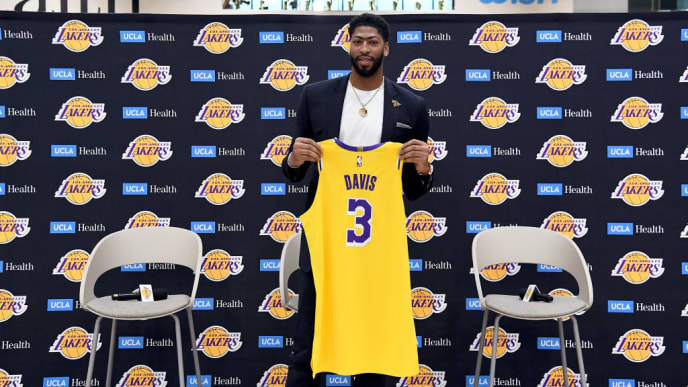EL SEGUNDO, CALIFORNIA - JULY 13: Anthony Davis poses with his jersey as he is introduced as the newest player of the Los Angeles Lakers during a press conference at UCLA Health Training Center on July 13, 2019 in El Segundo, California. NOTE TO USER: User expressly acknowledges and agrees that, by downloading and/or using this Photograph, user is consenting to the terms and conditions of the Getty Images License Agreement. (Photo by Kevork Djansezian/Getty Images)
