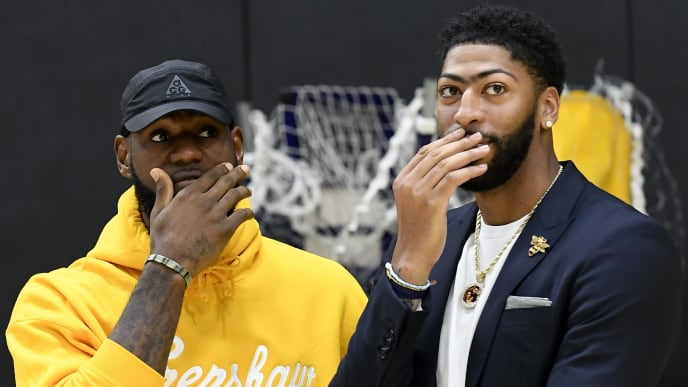 EL SEGUNDO, CALIFORNIA - JULY 13: Anthony Davis (R) talks with LeBron James as Davis is introduced as the newest player of the Los Angeles Lakers during a press conference at UCLA Health Training Center on July 13, 2019 in El Segundo, California. NOTE TO USER: User expressly acknowledges and agrees that, by downloading and/or using this Photograph, user is consenting to the terms and conditions of the Getty Images License Agreement. (Photo by Kevork Djansezian/Getty Images)