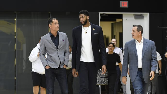 EL SEGUNDO, CALIFORNIA - JULY 13: Anthony Davis (C) arrives for the press conference to be introduced as the newest player of the Los Angeles Lakers with  general manager Rob Pelinka (L) during a press conference at UCLA Health Training Center on July 13, 2019 in El Segundo, California. NOTE TO USER: User expressly acknowledges and agrees that, by downloading and/or using this Photograph, user is consenting to the terms and conditions of the Getty Images License Agreement. (Photo by Kevork Djansezian/Getty Images)