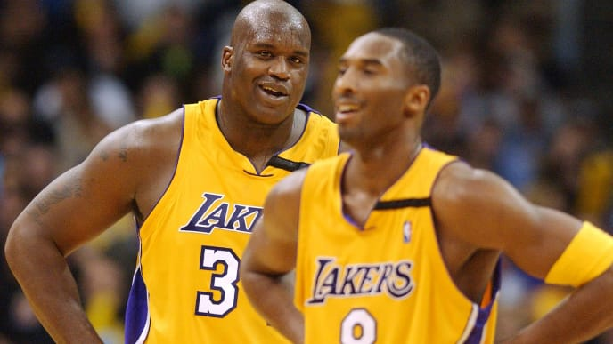 LOS ANGELES, UNITED STATES:  Los Angeles Lakers' center Shaquille O'Neal (L) laughs with guard Kobe Bryant in the fourth quarter during the Lakers' 86-73 win against the Chicago Bulls, in Los Angeles, CA, 22 November 2002.  O'Neal had surgery on his arthritic right big toe 11 September 2002 and is playing for the first time this season.   AFP PHOTO/Lucy NICHOLSON (Photo credit should read LUCY NICHOLSON/AFP via Getty Images)