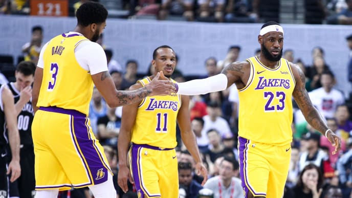 SHENZHEN, CHINA - OCTOBER 12:#23  LeBron James, #3 Anthony Davis and #11 Avery Bradley of the Los Angeles Lakers celebrate during the match against the Brooklyn Nets during a preseason game as part of 2019 NBA Global Games China at Shenzhen Universiade Center on October 12, 2019 in Shenzhen, Guangdong, China. (Photo by Zhong Zhi/Getty Images)