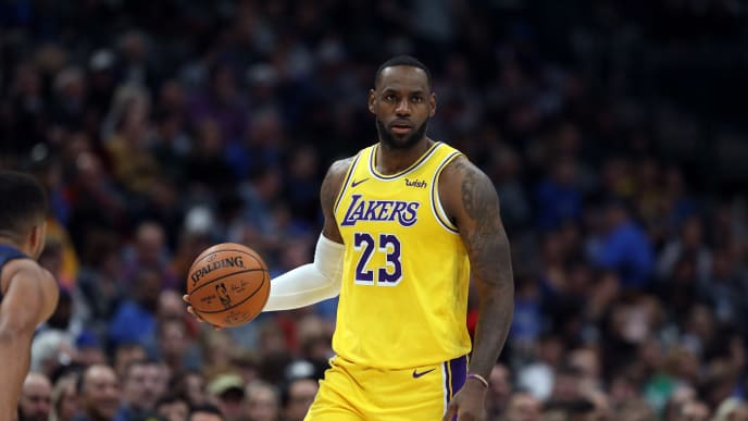 DALLAS, TEXAS - NOVEMBER 01:  LeBron James #23 of the Los Angeles Lakers dribbles the ball against the Dallas Mavericks in the second quarter at American Airlines Center on November 01, 2019 in Dallas, Texas.  NOTE TO USER: User expressly acknowledges and agrees that, by downloading and or using this photograph, User is consenting to the terms and conditions of the Getty Images License Agreement. (Photo by Ronald Martinez/Getty Images)