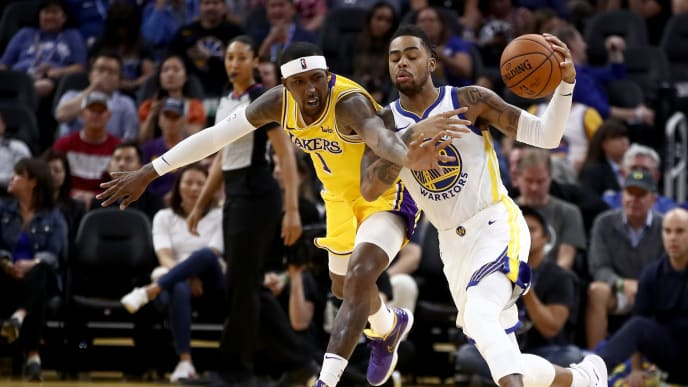 SAN FRANCISCO, CALIFORNIA - OCTOBER 05:  Kentavious Caldwell-Pope #1 of the Los Angeles Lakers and D'Angelo Russell #0 of the Golden State Warriors go for the ball at Chase Center on October 05, 2019 in San Francisco, California.  NOTE TO USER: User expressly acknowledges and agrees that, by downloading and or using this photograph, User is consenting to the terms and conditions of the Getty Images License Agreement.  (Photo by Ezra Shaw/Getty Images)