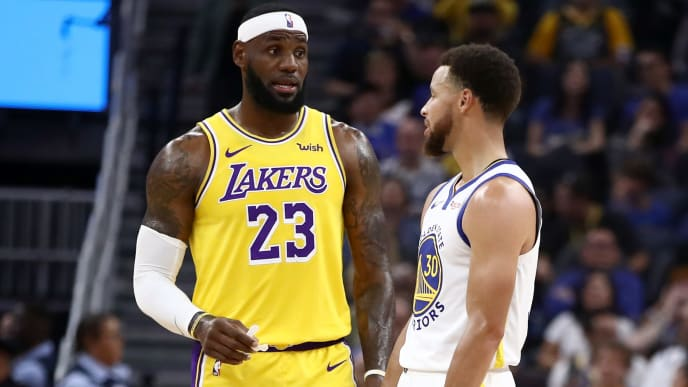 SAN FRANCISCO, CALIFORNIA - OCTOBER 05:  LeBron James #23 of the Los Angeles Lakers talks to Stephen Curry #30 of the Golden State Warriors during their game at Chase Center on October 05, 2019 in San Francisco, California.  NOTE TO USER: User expressly acknowledges and agrees that, by downloading and or using this photograph, User is consenting to the terms and conditions of the Getty Images License Agreement.  (Photo by Ezra Shaw/Getty Images)