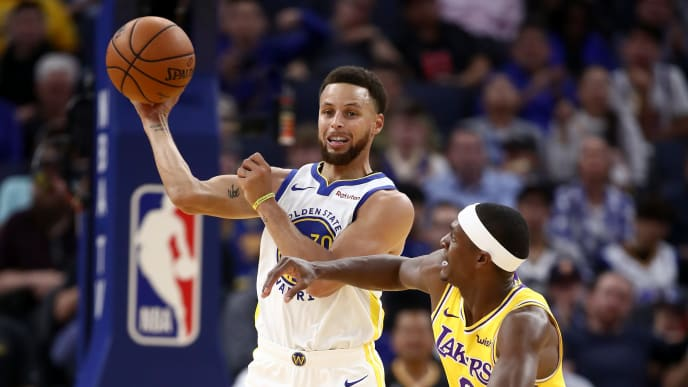 SAN FRANCISCO, CALIFORNIA - OCTOBER 05:  Stephen Curry #30 of the Golden State Warriors looks to pass around Rajon Rondo #9 of the Los Angeles Lakers at Chase Center on October 05, 2019 in San Francisco, California.  NOTE TO USER: User expressly acknowledges and agrees that, by downloading and or using this photograph, User is consenting to the terms and conditions of the Getty Images License Agreement.  (Photo by Ezra Shaw/Getty Images)
