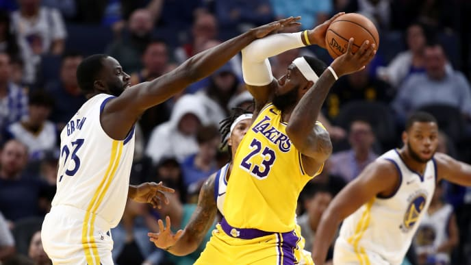 SAN FRANCISCO, CALIFORNIA - OCTOBER 05:  LeBron James #23 of the Los Angeles Lakers is guarded by Draymond Green #23 of the Golden State Warriors at Chase Center on October 05, 2019 in San Francisco, California.  NOTE TO USER: User expressly acknowledges and agrees that, by downloading and or using this photograph, User is consenting to the terms and conditions of the Getty Images License Agreement.  (Photo by Ezra Shaw/Getty Images)