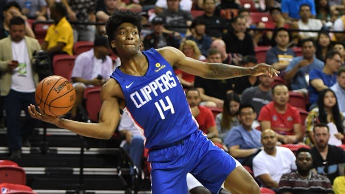 LAS VEGAS, NEVADA - JULY 06:  Terance Mann #14 of the LA Clippers saves the ball from going out of bounds during a game against the Los Angeles Lakers during the 2019 NBA Summer League at the Thomas & Mack Center on July 6, 2019 in Las Vegas, Nevada. NOTE TO USER: User expressly acknowledges and agrees that, by downloading and or using this photograph, User is consenting to the terms and conditions of the Getty Images License Agreement.  (Photo by Ethan Miller/Getty Images)