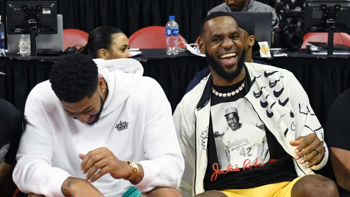 LAS VEGAS, NEVADA - JULY 06:  Anthony Davis (L) and LeBron James of the Los Angeles Lakers joke around before a game between the Lakers and the LA Clippers during the 2019 NBA Summer League at the Thomas & Mack Center on July 6, 2019 in Las Vegas, Nevada. NOTE TO USER: User expressly acknowledges and agrees that, by downloading and or using this photograph, User is consenting to the terms and conditions of the Getty Images License Agreement.  (Photo by Ethan Miller/Getty Images)